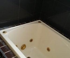 Bathtub with dark tiling installed newcastle